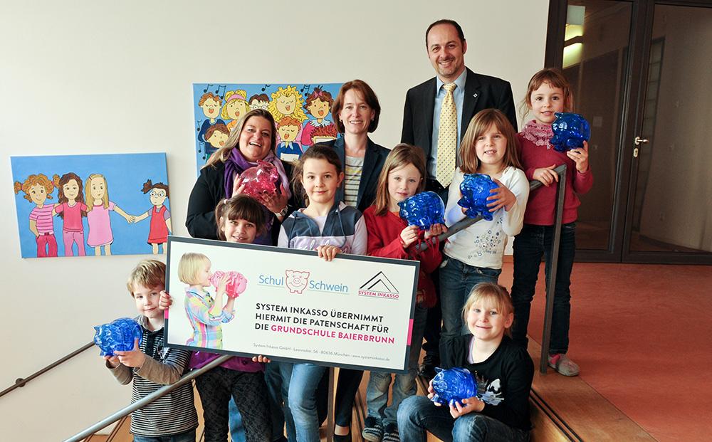 System Inkasso übernimmt die Patenschaft für die Grundschule Baierbrunn